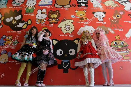"Melissa Lopez, Sandy J., Olivia R., Julie Doll Melissa Lopez, left, Sandy J., Olivia R. and Julie Doll, who came from Los Angeles to see the ""Small Gift celebrating 50 years of Sanrio"" exhibit at the Art Basel show in Miami's design district, pose for photos. Visitors to the exhibit could win prizes and get inked with Sanrio tattoos"