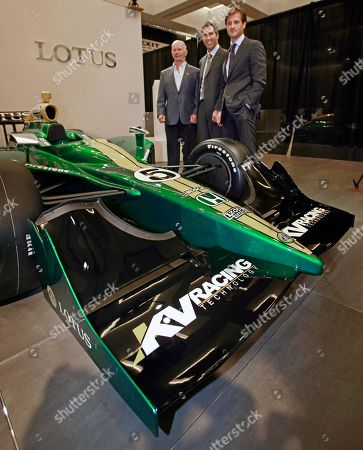 Race driving legend Parnelli Jones, from left, Indy Racing League chief executive officer Randy Bernard, and Group Lotus CEO Dany Bahar pose behind an Indy car during a news conference at the LA Auto Show, in Los Angeles. Lotus announced that the company would for the first time provide engines for Indy cars in the 2012 racing season