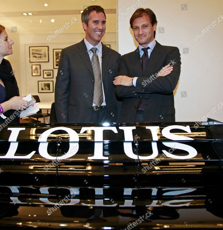 Indy Racing League chief executive officer Randy Bernard, left, and Group Lotus CEO Dany Bahar pose behind an Indy car during a news conference at the LA Auto Show, in Los Angeles. Lotus announced that the company would for the first time provide engines for Indy cars in the 2012 racing season