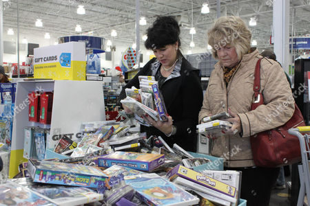 Miller Stephanie Miller, left, of Albuquerque and her mother, Norma, dig through a pile of video games and movies while shopping at an electronics store in Albuquerque, N.M., on . Shoppers around New Mexico hit the stores early to take advantage of Black Friday sales