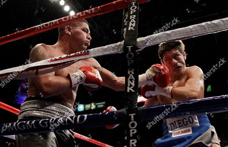 Derrick Campos, Diego Magdaleno Derrick Campos, left, lands a punch on Diego Magdaleno during a super featherweight boxing bout, in Las Vegas