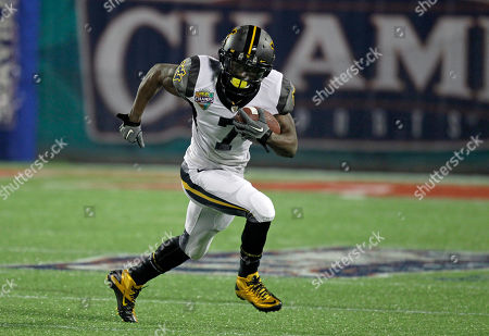 Stock Photo of Noel Devine West Virginia running back Noel Devine during the first half of the Champs Sports Bowl NCAA college football game against North Carolina State in Orlando, Fla