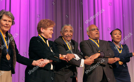 """Lucy Cline Huie, Dr. Deborah Lipstadt, Dr. Joseph Lowery, Robert Moses, Leah Ward Sears Recipients of the 2010 James Weldon Johnson medal, from left, Lucy Cline Huie, Dr. Deborah Lipstadt, Dr. Joseph Lowery, Robert Moses, and Leah Ward Sears join hands while singing """"We Shall Overcome"""" during a ceremony at the Carter Center in Atlanta"""