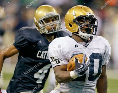 Remound Wright, John Turner Fort Wayne Bishop Dwenger's Remound Wright is chased by Indianapolis Cathedral's John Turner (4) during the second quarter of the IHSAA Class 4A football state championship game in Indianapolis