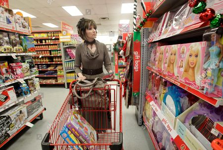 Taken, Polly Brown of Riesel, Texas, shops for holiday gifts at the Family Dollar store, in Waco, Texas. In September 2010, Family Dollar had announced plans to spend $750 million to buy back its stock, which would be partially funded by its cash on hand. Then in October, the retailer said it had repurchased $250 million of its shares as part of its previous announcement