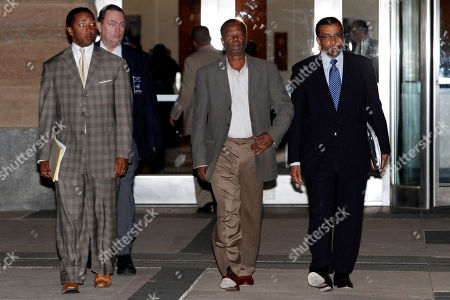 Prince George's County County Executive Jack Johnson, 61, center, leaves U.S. District Court with his lawyers, Brian McDaniel, left, and Billy Martin, in Greenbelt, Md. on . Johnson and his wife Leslie were arrested by federal law enforcement agents and charged with witness tampering and destruction of records