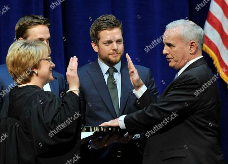 Mark Dayton, Lorie Skjerven Gildea Former U.S. Sen. Mark Dayton, right, takes the oath of office of Minnesota governor from Supreme Court Chief Justice Lorie Skjerven Gildea as sons Andrew, left, and Eric look on in St. Paul, Minn
