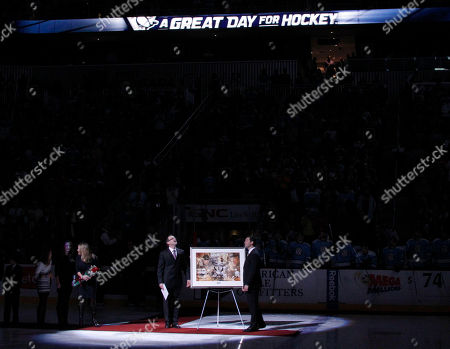 Bill Guerin, Dan Bylsma Pittsburgh Penguins coach Dan Bylsma, right, presents Bill Guerin with a frame art print in a ceremony honoring him for retiring as a Pittsburgh Penguin before the start of the NHL hockey game against the New Jersey Devils, in Pittsburgh
