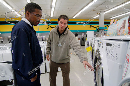 Bennett Chandler, Noel Freeman Graph Cowboy Maloney's Electric City sales associate Bennett Chandler, right, shows off the features of a new front loading dryer to Noel Freeman of Terry, Miss., during a visit to the appliance store in Jackson, Miss. The U.S. economy ended last year on an encouraging note, with all parts of the country showing improvements. Factories produced more, shoppers spent more and companies hired more. All those signs point to a stronger economy in 2011