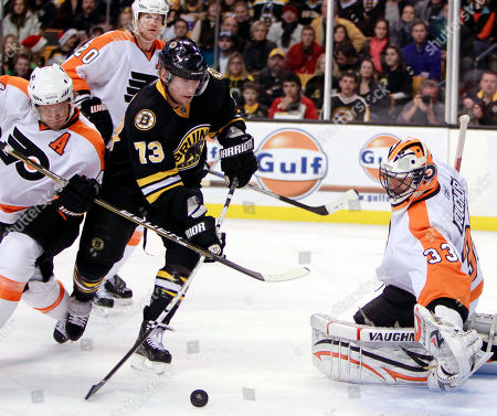 Michael Ryder, Ian Laperriere, Brian Boucher Boston Bruins' Michael Ryder (73) tries to get a shot off against Philadelphia Flyers' Brian Boucher (33) as the Flyers' Ian Laperriere, left, defends in the second period of an NHL hockey game, in Boston