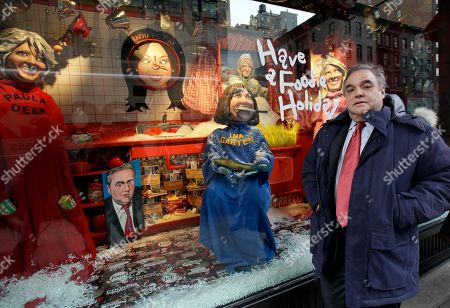 """Lee Schrager This photo shows South Beach and New York Wine & Food Festival founder and director Lee Schrager as he poses in front of the holiday window he helped design with a """"Have a Foodie Holiday,"""" theme at Barney's, in New York. Schrager lives in Miami, but spends about a quarter of the year in New York City, where he checked out possible sites for the 2011 city festival recently"""