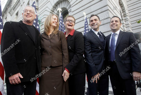 Activist Cleve Jones, left, is seen with plaintiffs Sandy Stier, second left, Kris Perry, center, Jeffrey Zarrillo, second right, and Paul Katami, right, outside of the courthouse before a hearing in the Ninth Circuit Court of Appeals, in San Francisco. The federal appeals court in San Francisco plans to hear two hours of arguments Monday about the voter-approved ban known as Proposition 8. A trial court judge overturned the measure as a violation of gay Californians' civil rights in August