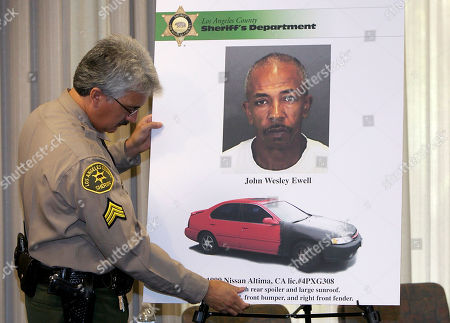 Los Angeles County Sheriff's Department Sgt. Richard Pena displays the double murder suspect John Wesley Ewell and his car, during a news conference in Los Angeles. Ewell is in police custody for a home invasion and robbery of, Leamon Turnage,69 and his wife Robyn,57. Hawthorne Police discovered the couple bodies, after deputies checked their home during a welfare check. Family members had been trying to reach the couple for days