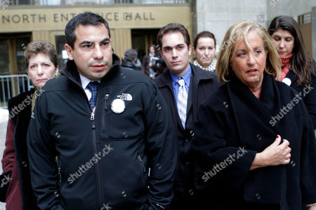 Stock Photo of Sylvie Cachay's brothers Patrick Orlando-Cachay, left, and David Orlando-Cachay, center, leave Manhattan Supreme court with their attorney Susan Karten after the arraignment of Nicholas Brooks in New York. Brooks pleaded not guilty to murdering his swimsuit designer girlfriend, Sylvie Cachay, in a trendy New York City hotel