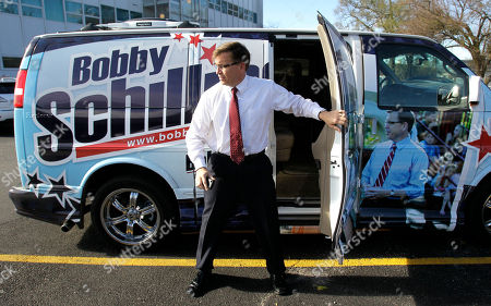 Bobby Schilling Rep.-elect Bobby Schilling, R-Ill., climbs out of his campaign van in Moline, Ill. Schilling, a pizzeria owner with 10 kids, is a tea partier who knocked off an established Democrat in a district that has gone Democrat, even liberal Democrat, for years
