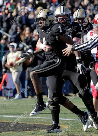 Keith Carlos, Justin Pierce Purdue running back Keith Carlos, left, celebrate with guard Justin Pierce after scoring a touchdown during the first half of an NCAA college football game in West Lafayette, Ind