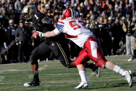 Keith Carlos, Jamie Lukaszewski Purdue running back Keith Carlos, left, breaks the tackle of Indiana linebacker Jeff Thomas on his way to picking up a first down during the first half of an NCAA college football game in West Lafayette, Ind