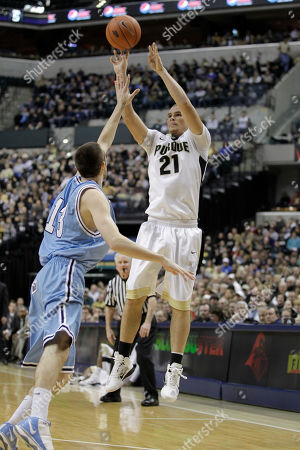 Jake Odum, D.J. Byrd Purdue forward D.J. Byrd, right, shoots over Indiana State guard Jake Odum in the first half of an NCAA college basketball game in Indianapolis