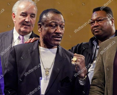 """Gerry Cooney, Larry Holmes, Joe Frazier Heavyweight boxing legend Gerry Cooney, left, and former heavyweight boxing champion Larry Holmes, right, join former champion Joe Frazier at a promotional boxing event for the FX channel's boxing drama series """"Lights Out,"""", at New York's Grand Central Station. Frazier, 67, known as Smokin' Joe, never fought Coooney or Holmes, but the former Olympic and World Heavyweight boxing champion career is highlighted by a win over Muhammad Ali twice, including the highly-anticipated """"Fight of the Century"""" in 1971"""