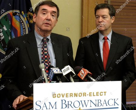 Dennis Taylor, left, the choice of Kansas Gov.-elect Sam Brownback to head a new office of the repealer, discusses making government more efficient as Brownback watches during a news conference, at the Statehouse in Topeka, Kan
