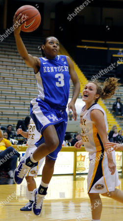 Stock Photo of Crystal Riley, Rachael Isom Kentucky guard Crystal Riley (3) launches a layup past Murray State guard Rachael Isom (10) during their NCAA college women's basketball game in the Lady Eagle Thanksgiving Classic tournament in Hattiesburg, Miss