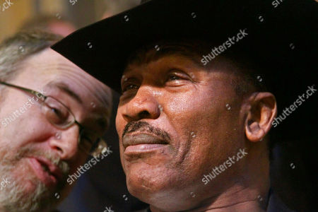 """Joe Frazier Former heavyweight boxing champion Joe Frazier, right, prepares to watch a promotional boxing event, at New York's Grand Central Station. Frazier, 67, known as Smokin' Joe, joined other boxing legends including, Larry Holmes, Gerry Cooney, Lennox Lewis and the current heavyweight champion Wladimir Klitschko, to promote the FX channel's boxing drama series """"Lights Out"""