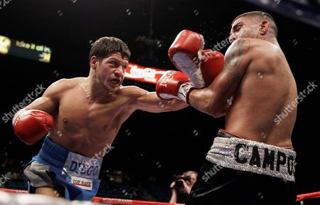 Diego Magdaleno, Derrick Campos Diego Magdaleno, left, lands a punch on Derrick Campos during a super featherweight boxing bout, in Las Vegas. Magdaleno won in the fourth round