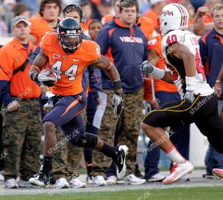 Raynard Horne, Matt Robinson Virginia running back Raynard Horne (44) heads down the side line as he is chased by Maryland defensive back Matt Robinson (40) during the first half of the NCAA college football game at Scott Stadium in Charlottesville, Va