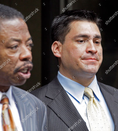 Security guard Alberto Alvarez, right, listens as his attorney Carl Douglas talks to reporters as they leave the preliminary hearing for Michael Jackson's doctor Conrad Murray who is charged in the death of the singer, at Los Angeles Superior Court