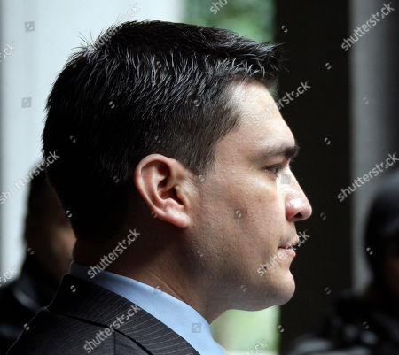 Security guard Alberto Alvarez listens as his attorney Carl Douglas talks to reporters as they leave the preliminary hearing for Michael Jackson's doctor Conrad Murray, charged in the death of the singer, at Los Angeles Superior Court