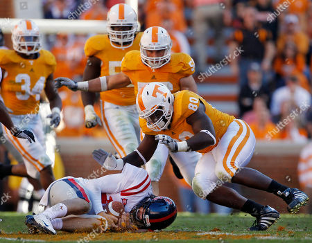 Stock Image of Nathan Stanley, Corey Miller Mississippi quarterback Nathan Stanley recovers his own fumble as Tennessee defensive end Corey Miller (80) closes in during the third quarter of an NCAA college football game against Tennessee on in Knoxville, Tenn. Stanley recovered the ball but lost 11 yards on the play