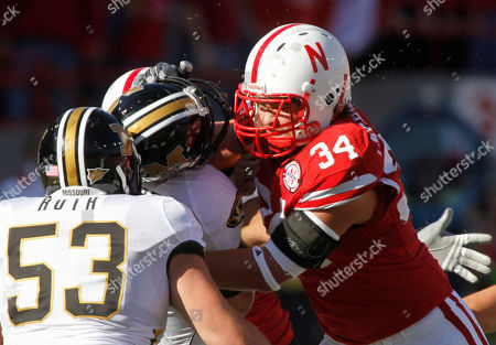 Stock Picture of Travis Ruth, Cameron Meredith Missouri quarterback Blaine Gabbert, center, is tackled by Nebraska defensive end Cameron Meredith (34) in the first half of an NCAA college football game in Lincoln, Neb., . Missouri offensive linesman Travis Ruth (53) looks on