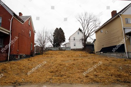 This empty lot shown, is what remains where the house owned by Andre Hall stood, in Pittsburgh's West End neighborhood. Hall's home had been leveled after city officials say a contractor mistakenly demolished it along with a neighboring house