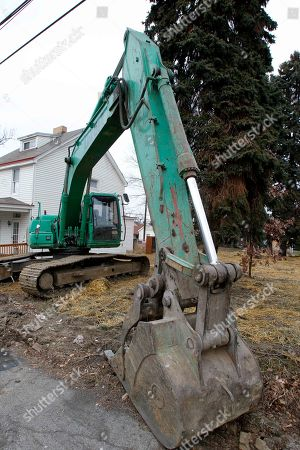 According to neighbors, this excavator, seen parked at a demolition site nearby,, was used to flatten the house owned by Andre Hall in Pittsburgh's West End neighborhood. Hall's home had been leveled after city officials say a contractor mistakenly demolished it along with a neighboring house