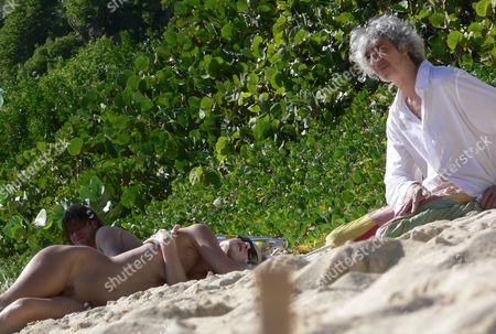 Louis Bertignac and girlfriend on the beach. Bertignac was a founding member of the rock band 'Telephone' and later formed 'Bertignac et les Visiteurs' before relasing solo material.