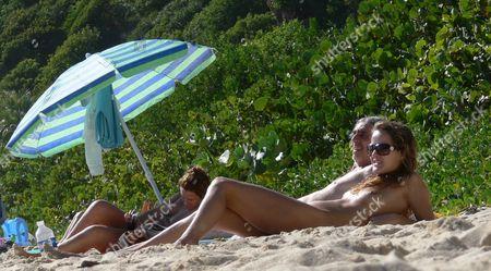 Louis Bertignac and girlfriend naked on the beach. Bertignac was a founding member of the rock band 'Telephone' and later formed 'Bertignac et les Visiteurs' before relasing solo material.