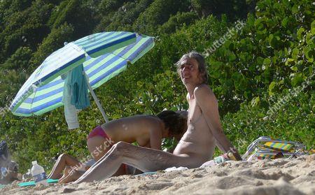 Louis Bertignac naked on the beach. Bertignac was a founding member of the rock band 'Telephone' and later formed 'Bertignac et les Visiteurs' before relasing solo material.
