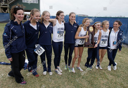 Members of the Villanova cross country team, from left, assistant coach Meghan Shaner, Sarah Morrison, Callie Hogan, Sheila Reid, Bogdana Mimic, Amanda Marino, Emily Lipari, Alison Smith and head coach Gina Procaccio hold the trophy after winning the women's NCAA Division I Cross-Country Championships in Terre Haute, Ind