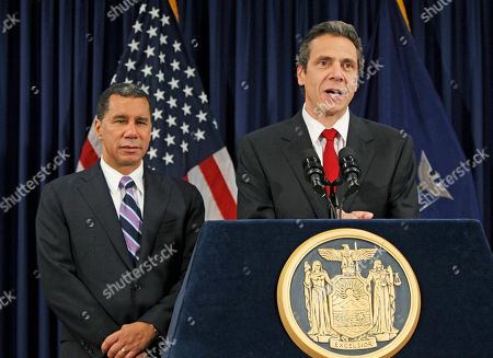 David Paterson, Andrew Cuomo New York Governor-elect Andrew Cuomo, right, speaks at a news conference following a private meeting between the outgoing New York Governor David Paterson, left, and incoming state leaders at Paterson's offices in New York