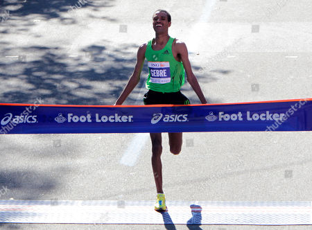 Gebre Gebremariam of Ethiopia crosses the finish line first in the men's division at the 2010 New York City Marathon in New York