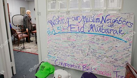 A poster board of signatures from Jewish supporters sits outside the doorway of a conference room as Muslim community leader Imam Feisal Abdul Rauf, left, prepares for an interview, in New York. The Imam is spearheading plans for a proposed Islamic cultural centre-- now called Park51, near the site of the September 11th terrorist attacks