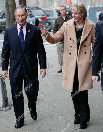 Mayor Michael Bloomberg, left, and Hearst Magazines chairwoman Cathie Black, New York's new schools chancellor, arrive for a visit to Public School 109 in the Bronx, in New York. It was Black's first public appearance a day after the state granted her a waiver to bypass state law requiring chancellors to have education experience