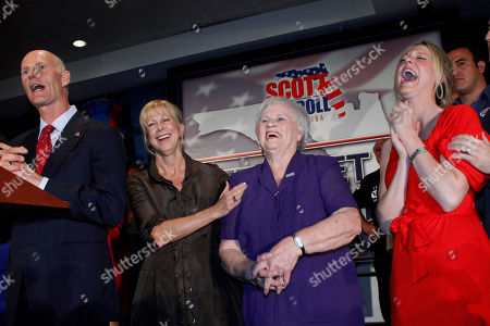 Rick Scott, Ann Scott, Esther Scott, Allison Guimard Esther Scott, second from right, mother of Florida Governor Rick Scott, left, shares a laugh with her son, his wife Ann, second from left, and her grandaughter Allison Guimard in Fort Lauderdale, Fla. The governor said that his mother died Tuesday afternoon in her hometown of Kansas City, Missouri. She was 84
