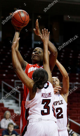 Natasha Thames, B.J. Williams, Jantel Lavender Ohio State's Jantel Lavender, top, goes up for a shot as Temple's B.J. Williams, lower left, and Natasha Thames defend during the first half of an NCAA women's college basketball game, in Philadelphia