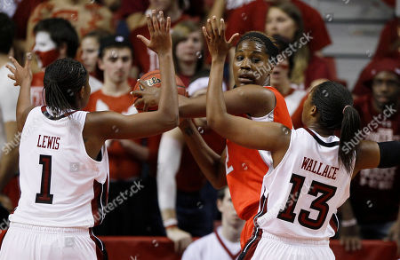 Jantel Lavender, Qwedia Wallace, Brittany Lewis Ohio State's Jantel Lavender, center, is pressured by Temple's Brittany Lewis, left, and Qwedia Wallace during the first half of an NCAA women's college basketball game, in Philadelphia