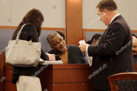 "Clarence Steward, David Roger, Melinda Weaver Clarence ""C.J."" Stewart, center, talks with Clark County district attorney David Roger, right, and attorney Melinda Weaver before pleading an equivalent of a no contest in Las Vegas, to felony robbery and conspiracy charges in Las Vegas. Stewart, who was O.J. Simpson's co-defendant, will be freed from prison to house arrest and an unspecified term of probation"