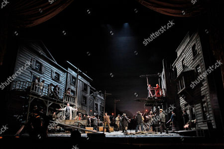 "Marcello Giordani, Lucio Gallo, Deborah Voigt This photo shows Lucio Gallo, left, performing as Jack Rance, alongside Marcello Giordani, top left, performing as Ramerrez and Deborah Voigt, top right, performing as Minnie during the final dress rehearsal of Giacomo Puccini's ""La Fanciulla del West"", at the Metropolitan Opera in New York"