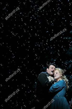 "Marcello Giordani, Deborah Voigt This photo shows Marcello Giordani, left, performing as Ramerrez alongside Deborah Voigt performing as Minnie during the final dress rehearsal of Giacomo Puccini's ""La Fanciulla del West"", at the Metropolitan Opera in New York"