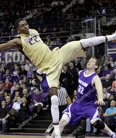 Justin Holiday, Ryan Nicholas Washington's Justin Holiday (22) flips back after being intentionally fould by Portland's Ryan Nicholas (32) on a late-game drive by Holiday in the second half of an NCAA college basketball game, in Seattle. Washington won 94-72
