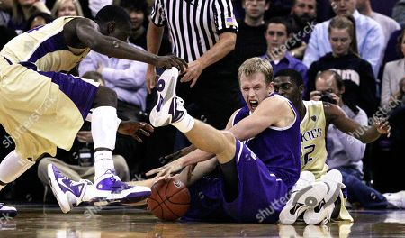 Justin Holiday, Darnell Gant, Luke Sikma Portland's Luke Sikma, center, reaches for a loose ball with Washington's Darnell Gant, left, and Justin Holiday in the first half of an NCAA college basketball game, in Seattle. Washington won 94-72